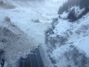 A glacier-sized avalanche at Snow Slide Gulch in Keystone Canyon has blocked the Richardson Highway and cut off the town of Valdez from road access.